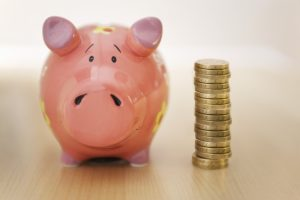 Car Insurance Bundle And Save - Picture Of Piggy Bank and Coins